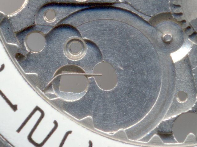 dial side: detail bearing date wheel with spring