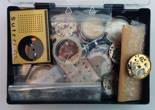 a box full of Ruhla parts